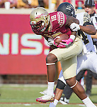 Florida State wide receiver Auden Tate drags Wake Forest safety Josh Okonye after a reception in the first half of an NCAA college football game in Tallahassee, Fla., Saturday, Oct. 15, 2016. Florida State defeated Wake Forest 17-6. (AP Photo/Mark Wallheiser)