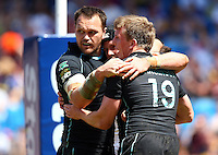 PICTURE BY VAUGHN RIDLEY/SWPIX.COM - Rugby League - Super League Magic Weekend - Catalans Dragons v London Broncos - Eithad Stadium, Manchester, England - 27/05/12 - London's Ben Bolger scores a try and celebrates with Mark Bryant and Dan Sarginson.