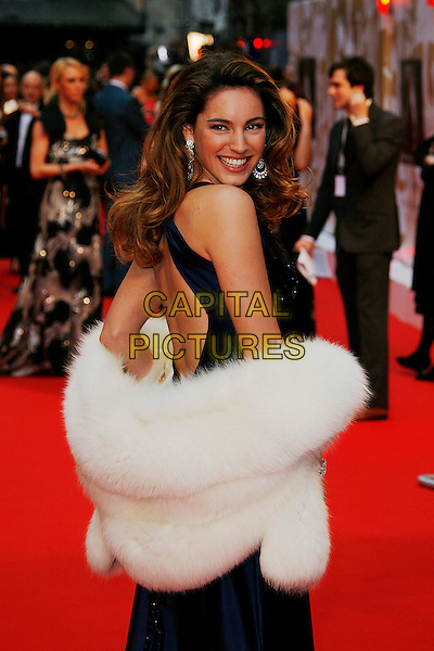 KELLY BROOK.Red Carpet Arrivals for the British Academy Television Awards 2008, held at the London Palladium, London, England, .April 20th 2008. .BAFTA BAFTA's half length blue silk satin dress white fur wrap shawl looking over shoulder .CAP/DAR.©Darwin/Capital Pictures.