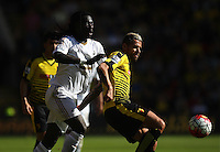 Bafetimbi Gomis of Swansea battles with Valon Behrami of Watford   during the Barclays Premier League match Watford and Swansea   played at Vicarage Road Stadium , Watford