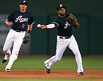 Reno Aces' Nick Ahmed, left, watches Andy Marte make a play against the Las Vegas 51s, in Reno, Nev., on Saturday, Sept. 6, 2014. The Aces won 7-3, to win the Pacific Conference Championship Series. <br /> Photo by Cathleen Allison