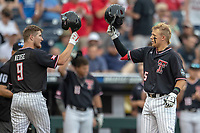 Texas Tech Red Raiders second baseman Brian Klein (5) is greeted by teammate Dylan Neuse (9) after hitting a home run during Game 1 of the NCAA College World Series against the Michigan Wolverines on June 15, 2019 at TD Ameritrade Park in Omaha, Nebraska. Michigan defeated Texas Tech 5-3. (Andrew Woolley/Four Seam Images)