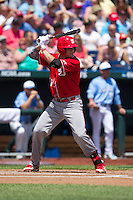 North Carolina State Wolfpack catcher Brett Austin #11 bats during Game 3 of the 2013 Men's College World Series between the North Carolina State Wolfpack and North Carolina Tar Heels at TD Ameritrade Park on June 16, 2013 in Omaha, Nebraska. The Wolfpack defeated the Tar Heels 8-1. (Brace Hemmelgarn/Four Seam Images)