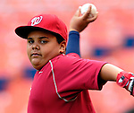 5 June 2007: Washington Nationals first baseman Dmitri Young's son Damon (age 7) warms up prior to facing the Pittsburgh Pirates at RFK Stadium in Washington, DC. The Pirates defeated the Nationals 7-6, in the first game of their 3-game series...Mandatory Credit: Ed Wolfstein Photo