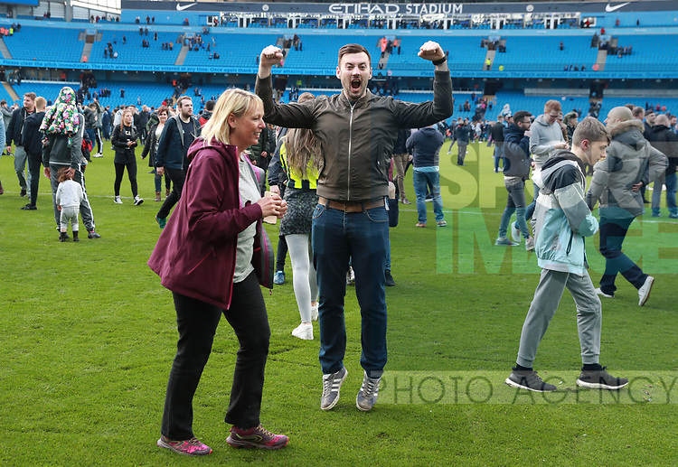 Manchester City fans celebrate by invading the pitch during the premier league match at the Etihad Stadium, Manchester. Picture date 22nd April 2018. Picture credit should read: Simon Bellis/Sportimage