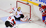 11 November 2008:  Ottawa Senators' goaltender Alex Auld makes a kick save against Montreal Canadiens' right wing forward Alexei Kovalev from Russia in the second period at the Bell Centre in Montreal, Quebec, Canada. The Canadiens, celebrating their 100th season, defeated the visiting Senators 4-0. ***Editorial Sales Only***..Mandatory Photo Credit: Ed Wolfstein Photo *** Editorial Sales through Icon Sports Media *** www.iconsportsmedia.com