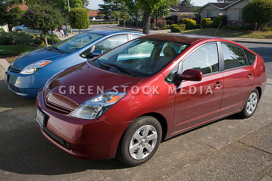 A side view of two parked Toyota Prius hybrid cars. Cupertino, California, USA
