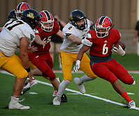 NWA Democrat-Gazette/ANDY SHUPE<br /> Farmington running back Jaden Schader (6) carries the ball Friday, Sept. 6, 2019, as Prairie Grove defensive end Graham Guenther (2) reaches to make the tackle during the first half of play at Cardinal Stadium in Farmington. Visit nwadg.com/photos to see more photographs from the game.