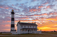 Cape Hatteras National Seashore, North Carolina: Sunrise colored clouds above the Bodie Island lighthouse (1872) on North Carolina's Outer Banks