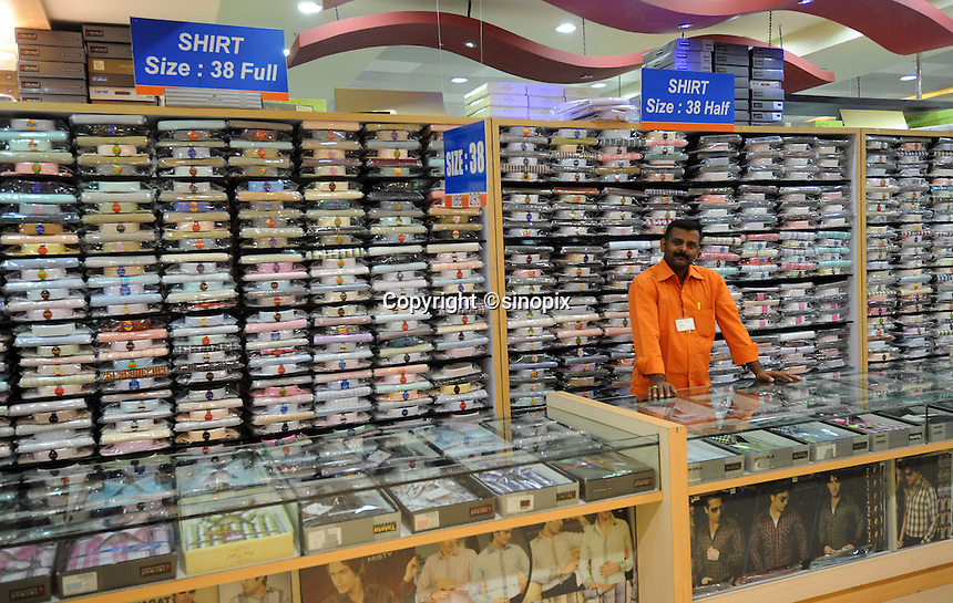 A shop keeper at the shirt counter at shirt shop in Madras, India