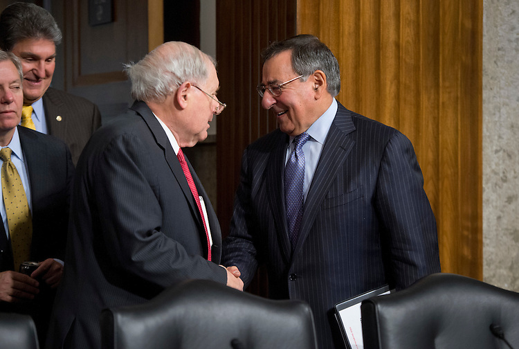 UNITED STATES - FEBRUARY 07:  Secretary of Defense Leon Panetta, right, and Chairman Carl Levin, D-Mich., talk before a Senate Armed Services Committee hearing featuring testimony by Panetta and Chairman of the Joint Chiefs of Staff Gen. Martin Dempsey, on the Defense Department's response to the attack on U.S. embassy in Benghazi, Libya, and discuss the findings of its internal review of the attack. (Photo By Tom Williams/CQ Roll Call)