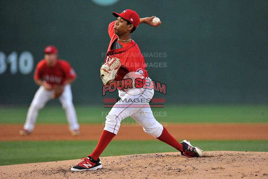 Starting pitcher Anderson Espinoza (23) of the Greenville Drive delivers a pitch in a game against the Columbia Fireflies on Saturday, April 23, 2016, at Fluor Field at the West End in Greenville, South Carolina. Columbia won, 7-3. (Tom Priddy/Four Seam Images)