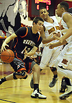 SIOUX FALLS, SD - FEBRUARY 14:  Brett Stanley #12 from Washington looks for a way to escape a double team by Chris Phillips #20 and Brandon Boggs #4 from Roosevelt in the second quarter of their game Thursday night at Washington. (Photo by Dave Eggen/Inertia)