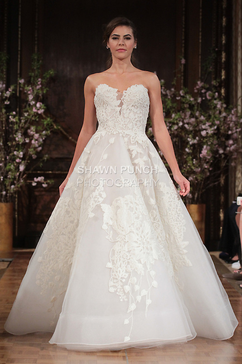 """Model walks runway in a """"Charlie"""" bridal gown from the Isabelle Armstrong Spring Collection 2017, at Lotte New York Palace Hotel, during New York Bridal Fashion Week Spring Summer 2017 on April 16, 2017."""