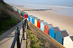 Colourful beach huts, wide sandy beach and sea, Mundesley, Norfolk, England