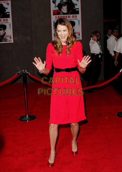 JACINDA BARRETT.The World Premiere of Ladder 49 held at The El Capitan Theatre in Hollywood, California.September 20, 2004.full length, red dress, hands, gesture, black belt, ribbon.www.capitalpictures.com.sales@capitalpictures.com.Copyright Debbie VanStory
