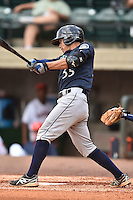 Pulaski Mariners catcher Carlton Tanabe #55 swings at a pitch during a game against the Greenville Astros at Pioneer Park July 12, 2014 in Greenville, Tennessee. The Mariners defeated the Astros 11-10. (Tony Farlow/Four Seam Images)