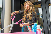 Dylan Lauren cuts the ribbon at the grand opening of her eponymous Dylan's Candy Bar in Union Square in New York on Tuesday, September 1, 2015. The new store, a downtown outpost of the Upper East Side flagship, is 3300 square feet in a high foot traffic location. Despite the candy, the average age of a Candy Bar customer is 30 years old.  (© Richard B. Levine)