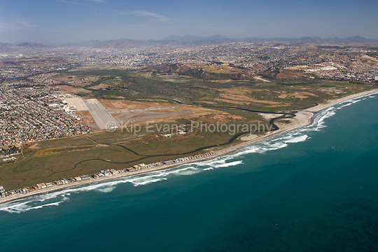 Aerial view of the Tijuana River National Estuarine Research Reserve looking southeast toward the U.S./Mexico Border and the city of Tijuana.
