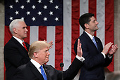 WASHINGTON, DC - JANUARY 30:  U.S. President Donald J. Trump delivers the State of the Union address as U.S. Vice President Mike Pence (L) and Speaker of the House U.S. Rep. Paul Ryan (R-WI) (R) look on in the chamber of the U.S. House of Representatives January 30, 2018 in Washington, DC. This is the first State of the Union address given by U.S. President Donald Trump and his second joint-session address to Congress.  <br /> Credit: Win McNamee / Pool via CNP