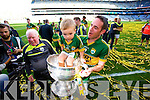 Declan O'Sullivan and his son Ollie. Kerry players celebrate their victory over Donegal in the All Ireland Senior Football Final in Croke Park Dublin on Sunday 21st September 2014.