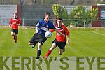 Dynamos v Athlone.Cian Dowd clears the ball out of the reach of Dynamos's Danny Roche