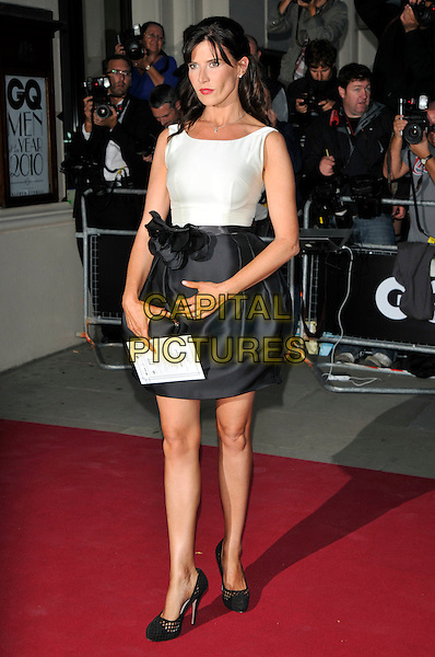 RONNI ANCONA .At the GQ Men of The Year Awards held at The Royal Opera House, Covent Garden, London, England, UK, September 7th 2010..full length skirt sleeveless shoes white dress black.CAP/PL.©Phil Loftus/Capital Pictures.