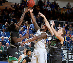 BROOKINGS, SD - DECEMBER 12: David Jenkins Jr. #5 from South Dakota State drives to the basket between Tray Buchanan #30 and Garrett Franken #24 from North Dakota during their game Tuesday night at Frost Arena in Brookings, SD. (Photo by Dave Eggen/Inertia)