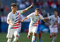 CARSON, CA - FEBRUARY 1: Ulysses Llanez Jr #19 of the United States takes a PK scores and celebrates during a game between Costa Rica and USMNT at Dignity Health Sports Park on February 1, 2020 in Carson, California.