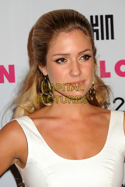KRISTIN CAVALLARI .Nylon Magazine's Young Hollywood Party held at the Roosevelt Hotel's Tropicana Bar,  Hollywood, California, USA, 12th May 2010..arrivals portrait headshot white sleeveless tanned sixties gold dangly earrings .CAP/ADM/BP.©Byron Purvis/AdMedia/Capital Pictures.