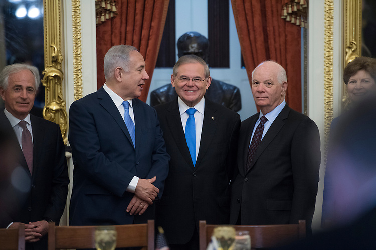 UNITED STATES - MARCH 06: Israeli Prime Minister Benjamin Netanyahu, second from left, poses for a picture with Chairman Bob Corker, R-Tenn., left, ranking member Sen. Bob Menendez, D-N.J., center, Sens. Ben Cardin, D-Md., and Jeanne Shaheen, D-N.H., in the Capitol before a meeting with members of the Senate Foreign Relations Committee on March 06, 2018. (Photo By Tom Williams/CQ Roll Call)