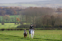 Mother and daughter ride together in rolling hillside, The Cotswolds, Oxfordshire, United Kingdom