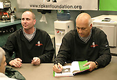 April 13, 2004:  Hall of Fame shortstop Cal Ripken and brother Billy during an appearance with the Rochester Red Wings, Triple-A International League affiliate of the Minnesota Twins, before a game at Frontier Field in Rochester, NY.  Photo by:  Mike Janes/Four Seam Images