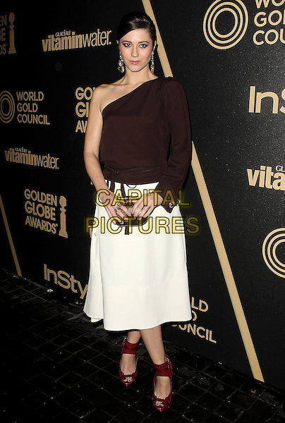 Mary Elizabeth Winstead.The Hollywood Foreign Press Association And InStyle Miss Golden Globe 2013 Party held at Cecconi's Restaurant, West Hollywood, California, USA, 29th November 2012..full length brown burgundy one sleeve shoulder top white skirt  red shoes gold clutch bag .CAP/ADM/KB.©Kevan Brooks/AdMedia/Capital Pictures.