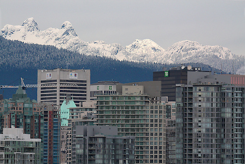VANCOUVER'S SKYLINE IS DWARFED BY THE LOCAL MOUNTAINS IN BRITISH COLUMBIA,CANADA