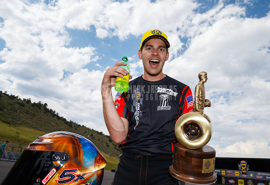 Jul 24, 2016; Morrison, CO, USA; NHRA pro stock motorcycle rider Andrew Hines celebrates after winning the Mile High Nationals at Bandimere Speedway. Mandatory Credit: Mark J. Rebilas-USA TODAY Sports