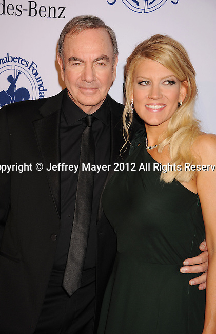 BEVERLY HILLS, CA - OCTOBER 20: Neil Diamond and Katie McNeil  arrive at the 26th Anniversary Carousel Of Hope Ball presented by Mercedes-Benz at The Beverly Hilton Hotel on October 20, 2012 in Beverly Hills, California.
