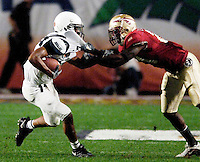 FSU's Trevor Ford holds on to Penn State's Jordan Norwood to prevent him from gaining any additional yardage on the 21 yard pass play in the second quarter of the 2006 FedEx Orange Bowl Game.