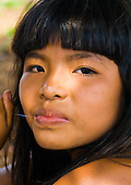 Xingu Indigenous Park, Mato Grosso State, Brazil. Aldeia Waura; young woman.