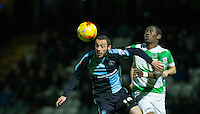 Michael Harriman of Wycombe Wanderers beats Nathan Smith of Yeovil Town to the ball during the Sky Bet League 2 match between Yeovil Town and Wycombe Wanderers at Huish Park, Yeovil, England on 24 November 2015. Photo by Andy Rowland.