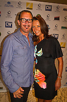 "Manly, New South Wales /Australia (Thursday, February 16, 2012) Layne Beachley (AUS)  with husband Kirk Pengilly (AUS) best known as the guitarist, saxophonist and principal backing vocalist of the iconic Australian rock band, INXS. The Australian surfing tribe gathered in Manly last night to honour big-wave legend Ross Clarke-Jones as he was inducted into the Australian Surfing Hall of Fame...Clarke-Jones became the 34th Inductee into the Hall of Fame in front of more than 400 people at a gala function at the Manly Novotel...The 45-year-old was overwhelmed and humbled by the honour...""I am completely humbled,"" Clarke-Jones said. ""When you look at the guys on there I think Im not worthy. These guys are world champions, they design stuff everyone surfs on. Im really taken aback to be part of this list...""Its a bit like a bookend, but Im not ready to retire yet. With the whole Storm Surfer thing it feels like Im starting again. I feel like a spring chicken...""Im honoured to be recognised as its something I never dreamed of receiving."".World No.3 Owen Wright was named the Male Surfer of the Year; womens World No.2 Sally Fitzgibbons was named Female Surfer of the Year; and ASP Womens Rookie of the Year Tyler Wright won the Rising Star Award...Ten-time Molokai paddleboard champion and winner of the recent Biggest Paddle Award in the ASL Oakley Big-Wave Awards Jamie Mitchell won the inaugural Waterman Award...The ASB Surfing Spirit Award was won by 1988 World Champion Barton Lynch for his tireless efforts to training and mentoring the surfing champions of tomorrow including organising the successful BLs Blast Off event for junior surfers.. Photo: joliphotos.com"