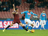 Cristian Molinaro of torino challenges Napoli's Miguel Allan  during the  italian serie a soccer match,between SSC Napoli and Torino      at  the San  Paolo   stadium in Naples  Italy , January 07, 2016