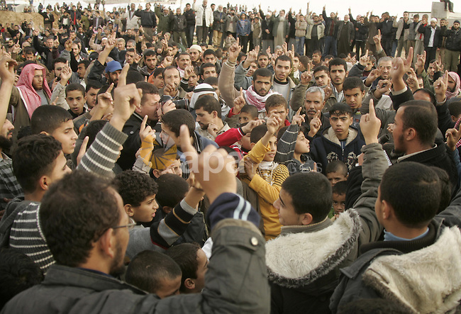Palestinians take part in a protest near the border between the Gaza Strip and Egypt on December 31, 2009 against the underground barrier Egypt is building along its border with the Gaza Strip. Egypt has only implicitly confirmed the construction of the underground wall, which was first reported by Israeli media, saying it is aimed at shutting down the extensive network of smuggling tunnels along the border. Photo by Abed Rahim Khatib