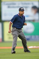 Umpire Eric Hill works the bases during a South Atlantic League game between the Lake County Captains and the Kannapolis Intimidators at Fieldcrest Cannon Stadium May 1, 2009 in Kannapolis, North Carolina. (Photo by Brian Westerholt / Four Seam Images)