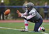 Plainview JFK No. 7 Kevin Pastier takes a snap and holds during a successful PAT attempt in the first quarter of a Nassau County Conference I varsity football game against Port Washington at Plainview JFK High School on Saturday, October 3, 2015. Plainview JFK won by a score of 42-0.<br /> <br /> James Escher