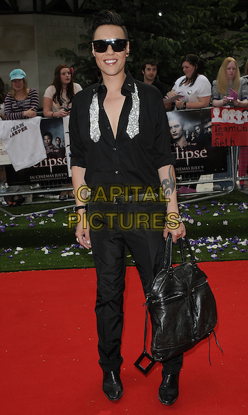 "GOK WAN.UK Gala Premiere of ""The Twilight Saga: Eclipse"" at the Odeon Leicester Square, London, England, UK..July 1st 2010.full length black trousers shirt bag leather tattoos sunglasses shades sparkly silver tie.CAP/CAN.©Can Nguyen/Capital Pictures."