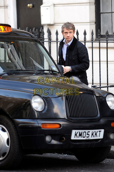 "MARTIN FREEMAN.Filming on the set of ""Sherlock"", Warren Street, London, England..March 6th, 2010.*EXCLUSIVE*.TV series film movie full length black jacket coat taxi cab car .CAP/IA.©Ian Allis/Capital Pictures."