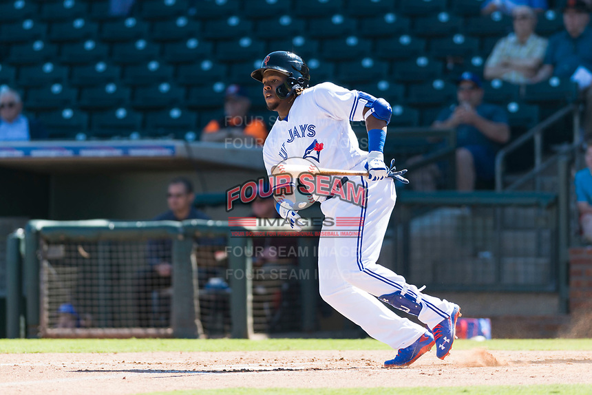 Surprise Saguaros designated hitter Vladimir Guerrero Jr. (27), of the Toronto Blue Jays organization, starts down the first base line during an Arizona Fall League game against the Peoria Javelinas at Surprise Stadium on October 17, 2018 in Surprise, Arizona. (Zachary Lucy/Four Seam Images)