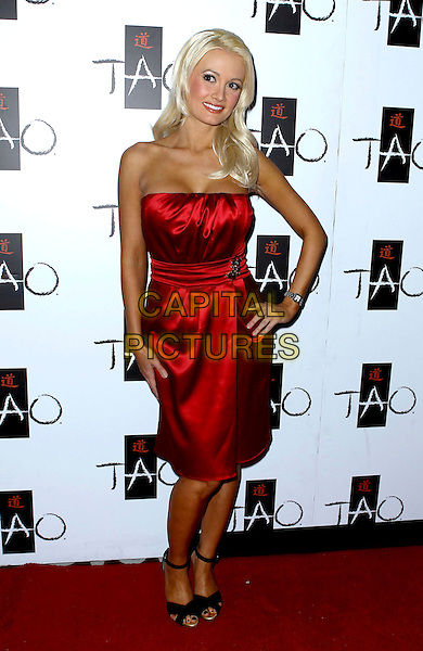HOLLY MADISON .21st Birthday Party for Angel Porrino at Tao Nightclub inside the Venetian Resort Hotel and Casino, Las Vegas, Nevada, USA, 6th May 2010..full length strapless red silk satin dress hand on hip black ankle strap shoes tanned .CAP/ADM/MJT.© MJT/AdMedia/Capital Pictures.