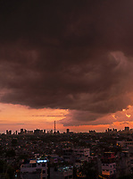 Project_The view from my Balcony. <br /> Images from daily life on the streets looking down from my balcony. <br /> But this is also the season for spectacular sunsets, crazy and bizarre cloud formations with awesome shapes and colours, and the occasional lightning storm brewing on the horizon, but sadly also fires that engulf whole suburbs.<br /> <br /> Confined Space, the view from my Balcony. March, April,May and into July during the lockdown and curfew in Manila 2020, COVID-19, Pandemic.